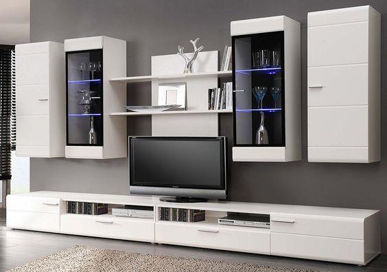 Với không gian phòng khách rộng hơn 1 chút bạn có thể tham khảo mẫu tủ trên.