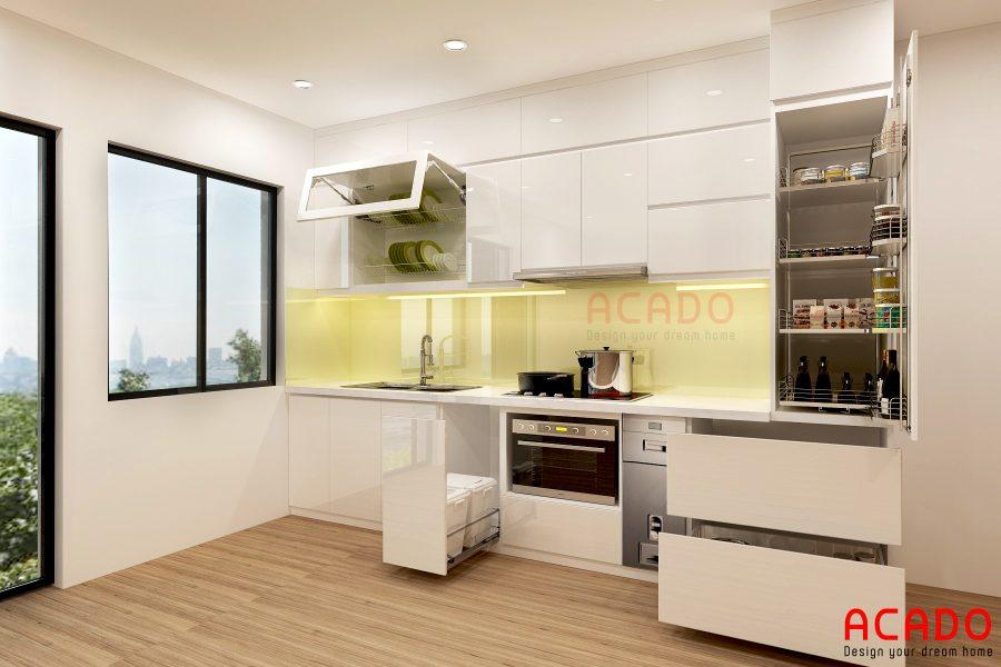 Tủ bếp Acrylic trắng kết hợp với kính bếp vàng chanh nhẹ nhàng.