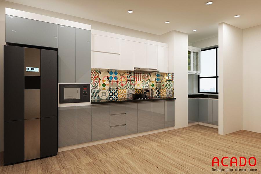 Ý tưởng cho căn bếp của gia chủ. Chất liệu cốt chống ẩm cánh phủ acrylic bóng gương lấy màu trắng làm màu chủ đạo. Kết hợp ốp gạch bông làm điểm nhấn tuyệt vời cho không gian bếp