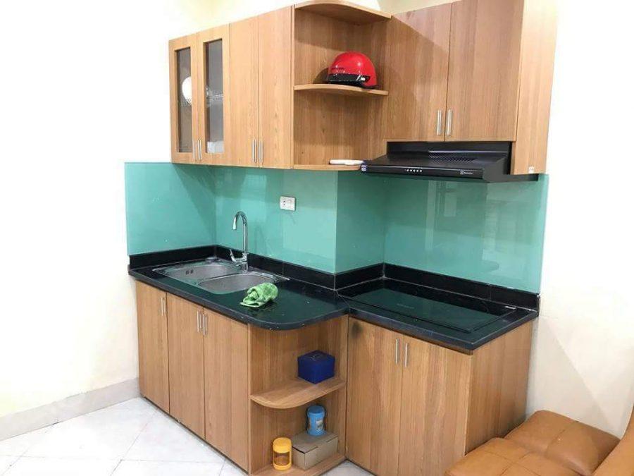 Mẫu tủ bếp Melamine vân gỗ hình dáng chữ i cho căn hộ có diện tích nhỏ