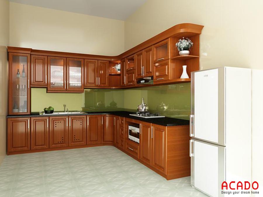 Mẫu tủ bếp gỗ xoan đào hình chữ L luôn tạo cảm hứng cho các mẹ nội trợ mỗi khi vào bếp