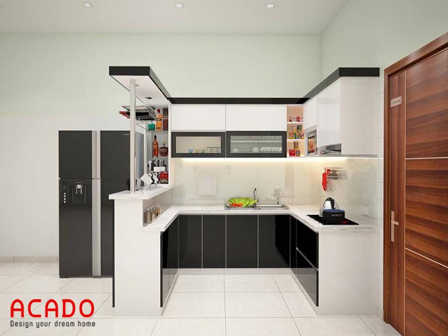 Tủ bếp Acrylic sáng bóng kết hợp với quầy bar tạo ra không gian bếp hiện đại, trẻ trung