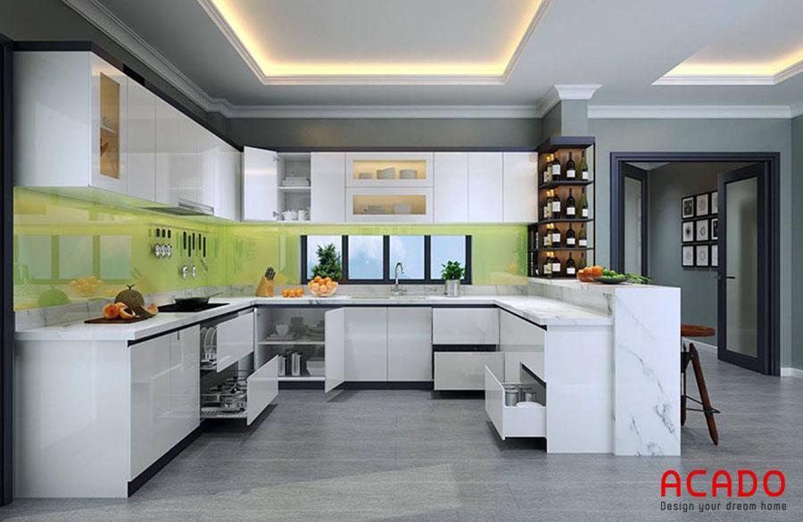 Tủ bếp acrylic thiết kế kết hợp quầy bar dành cho căn bếp rộng rãi, giúp cho thao tác nấu nướng thoải mái