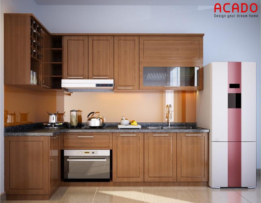 Sang trọng, ấm cúng và tiện nghi là điều mà mẫu tủ bếp gỗ sồi Mỹ hình chữ L này mang lại