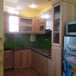 Tủ bếp gỗ xoan đào tự nhiên kết hợp tủ rượu sang trọng - ACADO thi công tủ bếp tại Yết Kiêu, Hà Đông