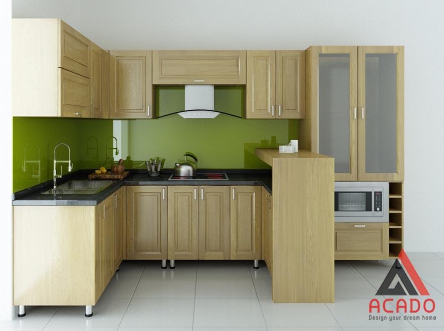 Mẫu tủ bếp gỗ sồi Mỹ có quầy bar với màu gỗ tự nhiên được rất nhiều gia đình ưa thích lựa chọn.