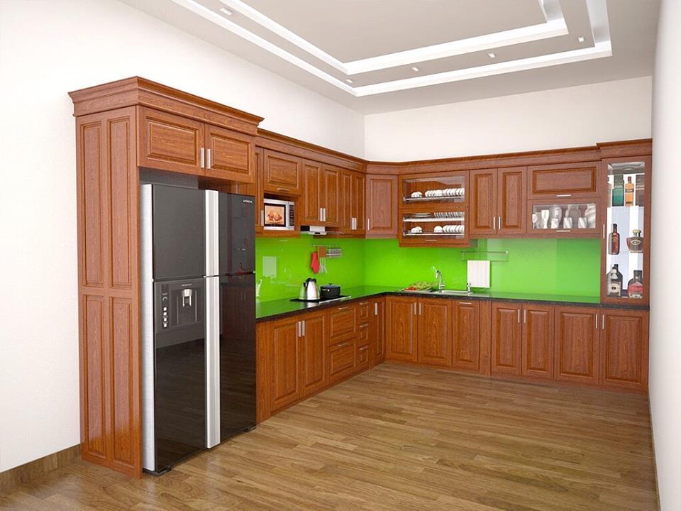 Tủ bếp gỗ xoan đào chữ L sơn màu cánh gián nhạt cho căn bếp thêm ấm cúng.
