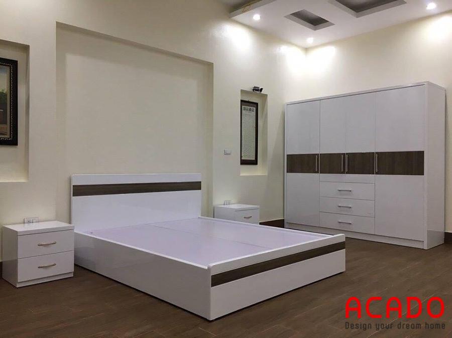 Tủ quần áo và giường ngủ cùng tông màu trắng trẻ trung.