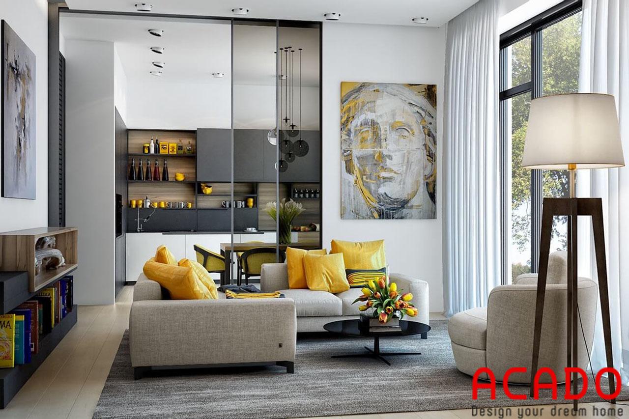 Phòng khách được thiết kế phong cách hiện đại, tone màu nhẹ nhàng màu vàng làm đểm nhấn