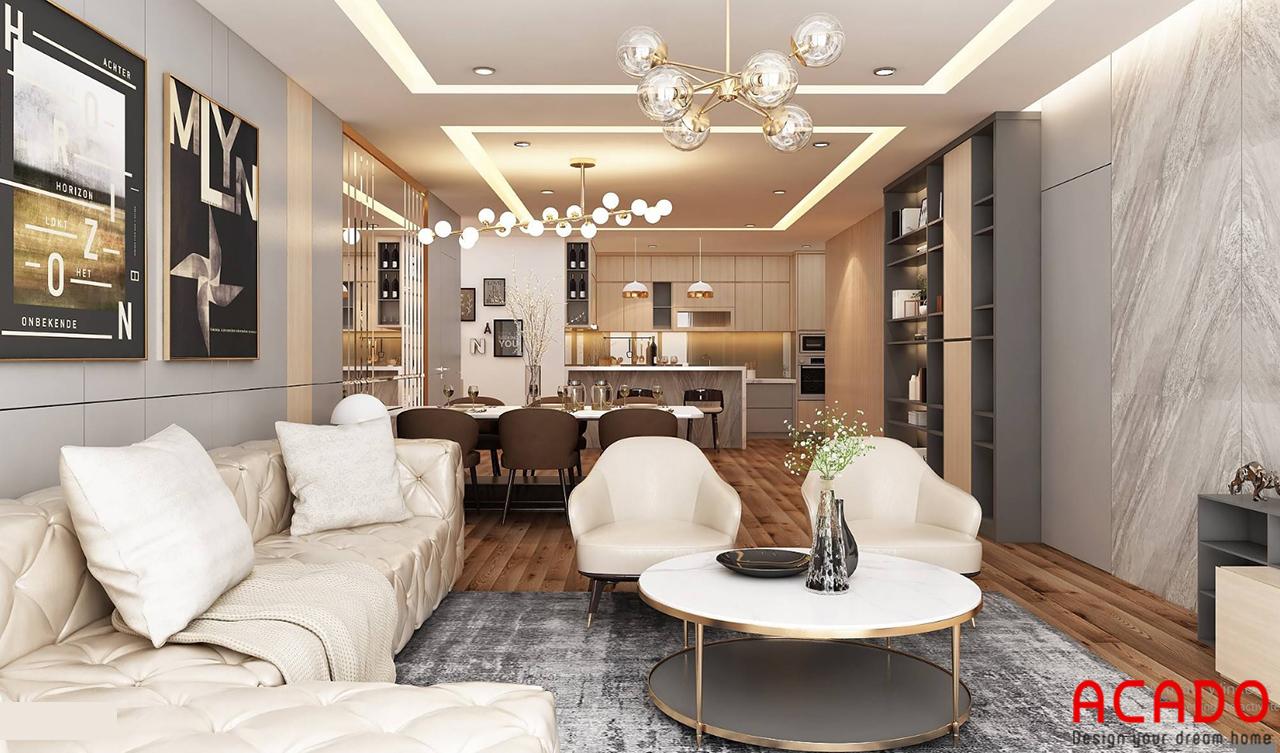 Nội thất phòng khách được bố trí đẹp mắt và tinh tế với bộ sofa trắng