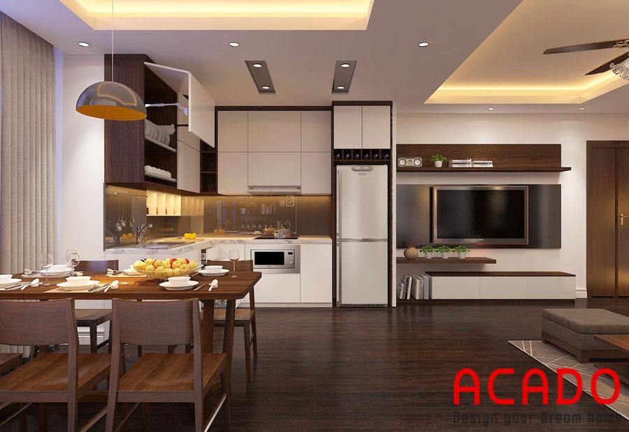 Phòng bếp được thiết kế bộ bàn ghế ăn sang trọng và bộ tủ bếp gỗ công nghiệp trắng