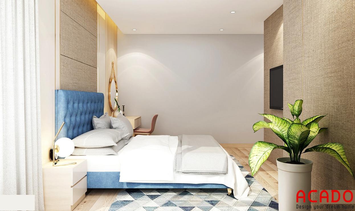 Giường ngủ màu kem kết hợp chút màu xanh dương làm điểm nhấn