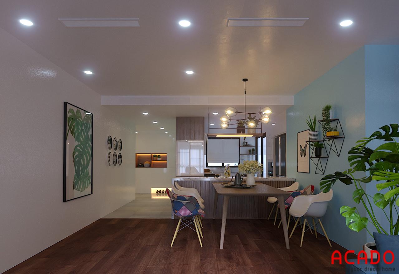 Phòng bếp bố trí bộ bàn ghế ăn và tủ bếp đầy đủ tiện nghi