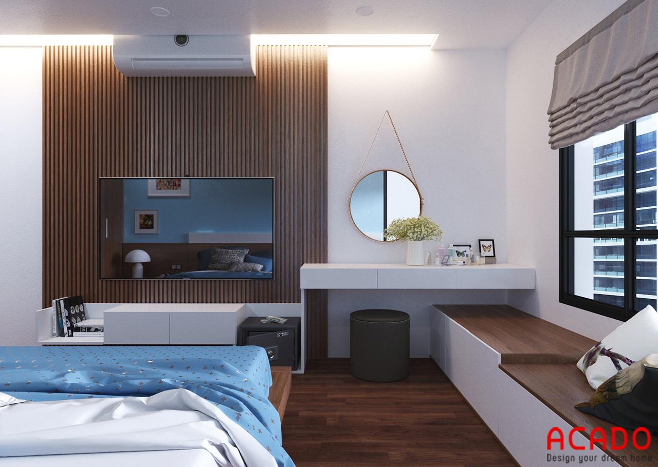 Phía đuôi giường thiết kế bàn trang điểm và kệ tivi