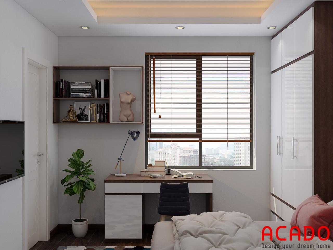 Bàn làm việc và giá sách thiết kế phía của sổ để lấy ánh sáng và thoáng mát